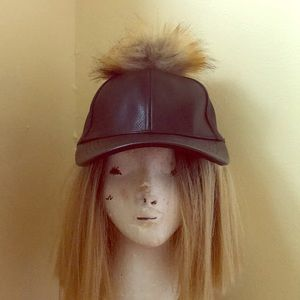 Black hat with furry ball on top
